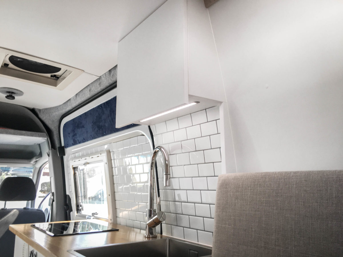 Top cabinet with lighting in DIY Campervan